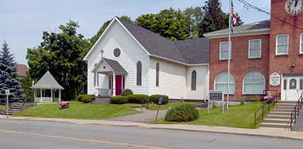Pictured above: a view of the Stamford United Methodist Church and the Stamford Village Hall, looking North across Main St / Route 23.